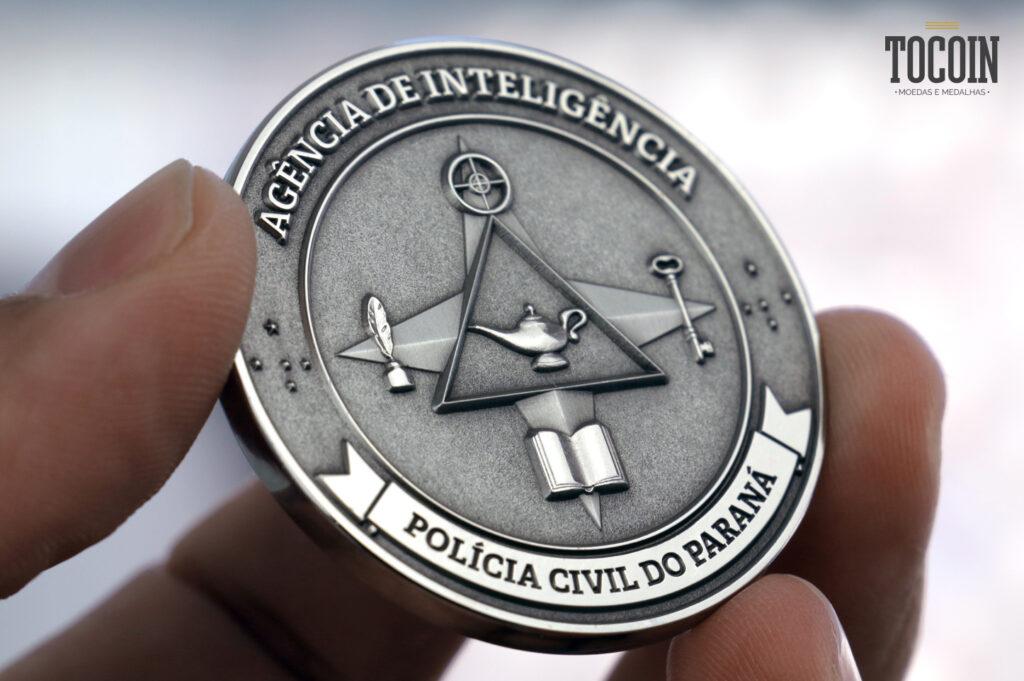 moeda da polícia civil do paraná