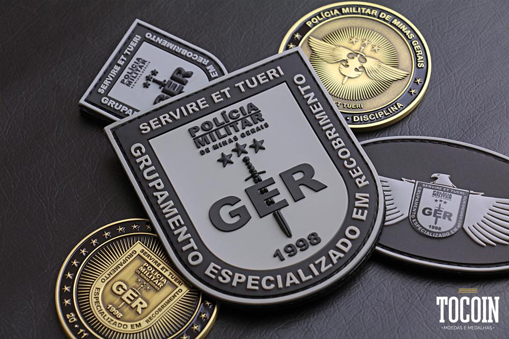 Distintivo emborrachado do Grupamento Especializado em Recobrimento da PMMG.