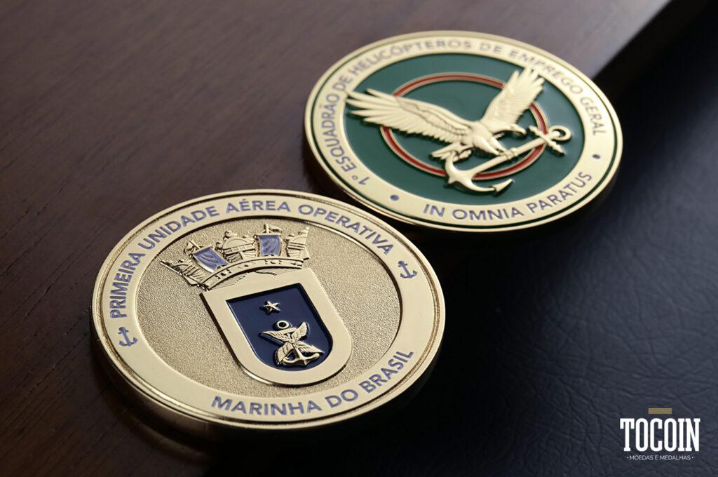 Duas moedas do 1ºEsquadrão de Helicópteros de Emprego Geral da Marinha do Brasil